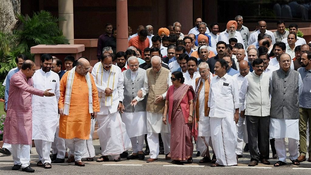 Prime Minister Narendra Modi surrounded by his Cabinet ministers and seniors BJP members.