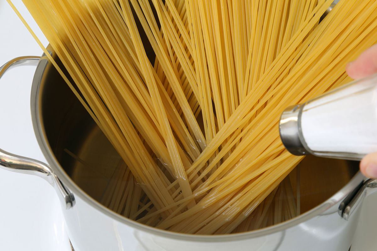 Mixing salt to pasta water helps season both the pasta and the water.