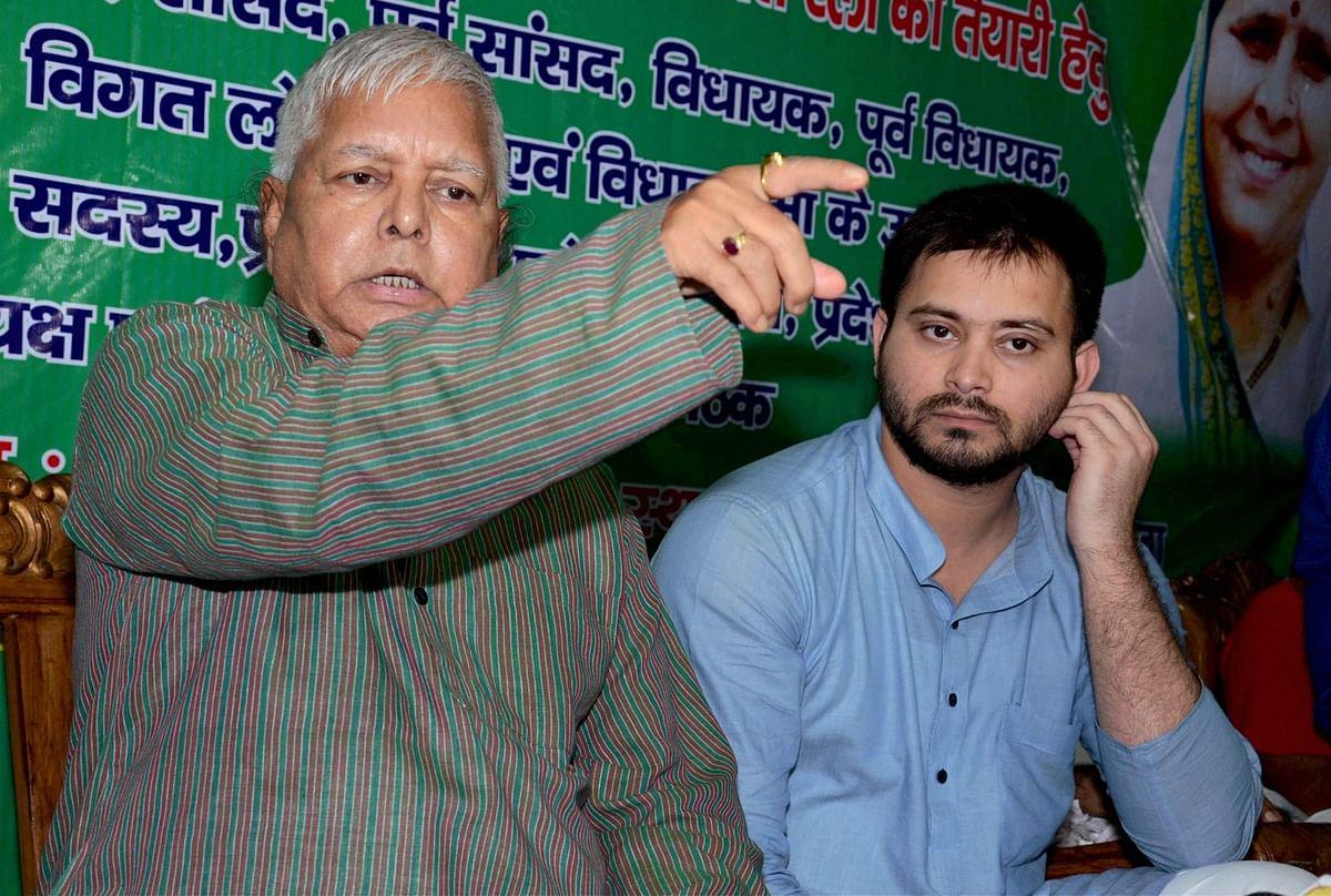 RJD supremo Lalu Yadav with his son Tejashwi Yadav.