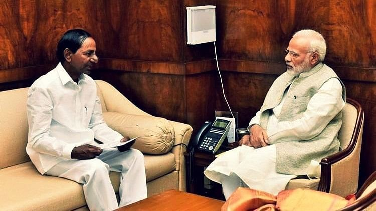 Telangana chief minister (L) with Modi (R).