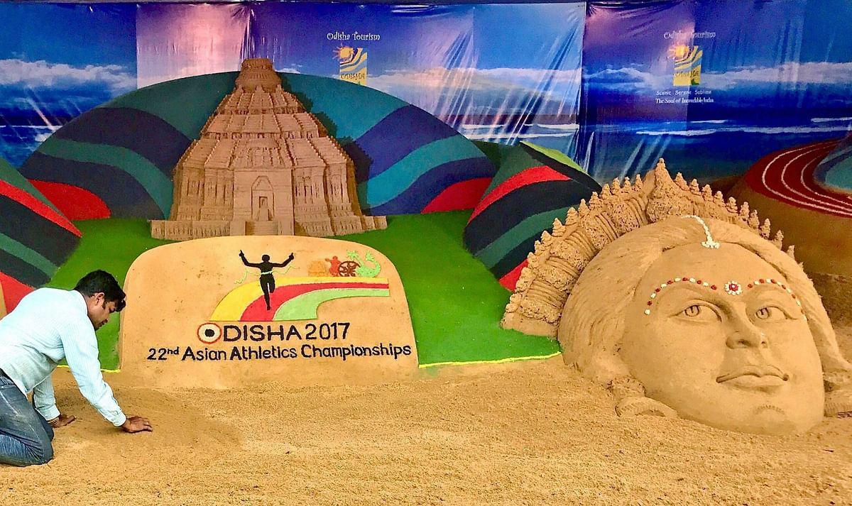 Sand artist Sudarsan Pattnaik creates a sand sculpture at 22nd Asian Athletics Championships in Kalinga Stadium in Bhubaneswar on Wednesday.
