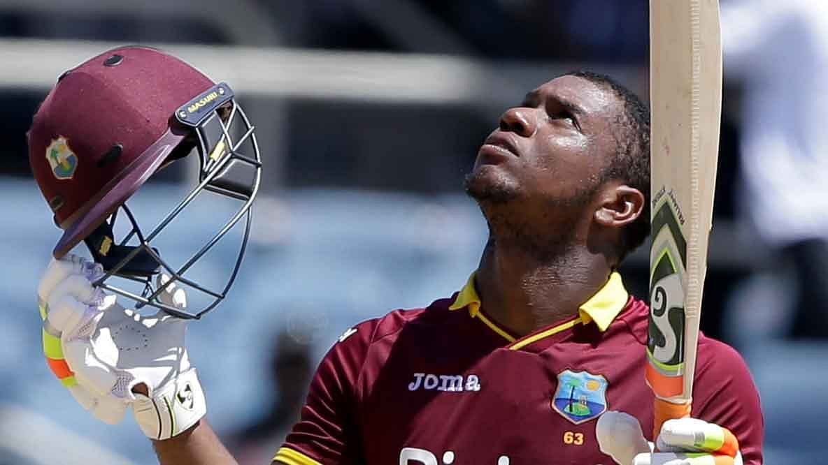 File photo of West Indies cricketer Evin Lewis celebrating after scoring a century in the one-off T20 against India.