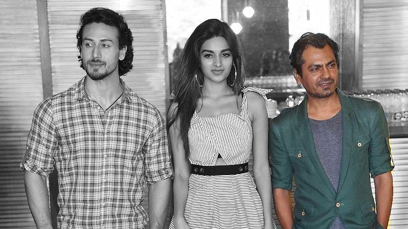 Nawazuddin Siddiqui (R) with Tiger Shroff and Nidhi Agarwal.