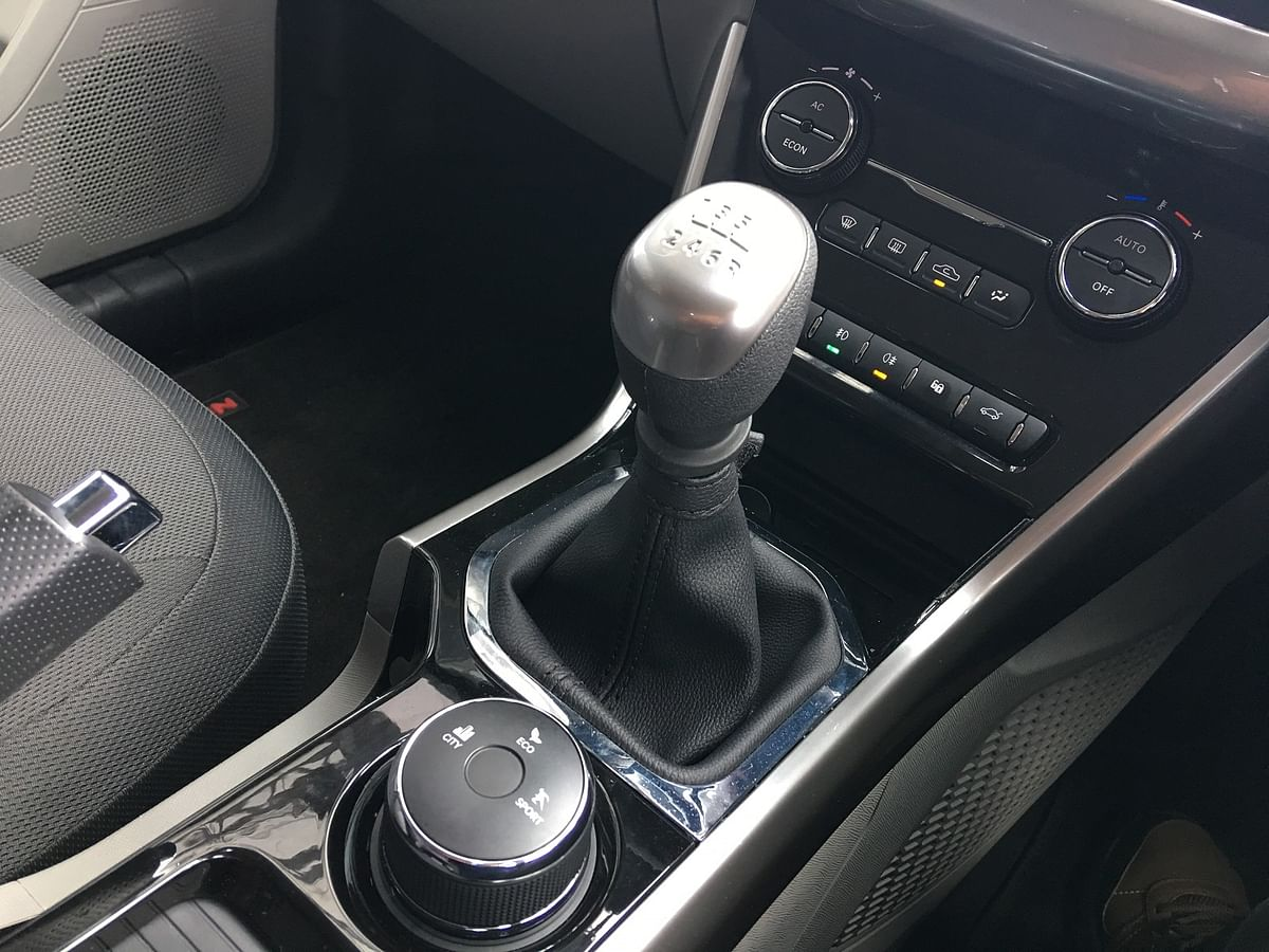 The six-speed manual transmission and the drive-mode knob that can switch between City, Eco and Sport modes.