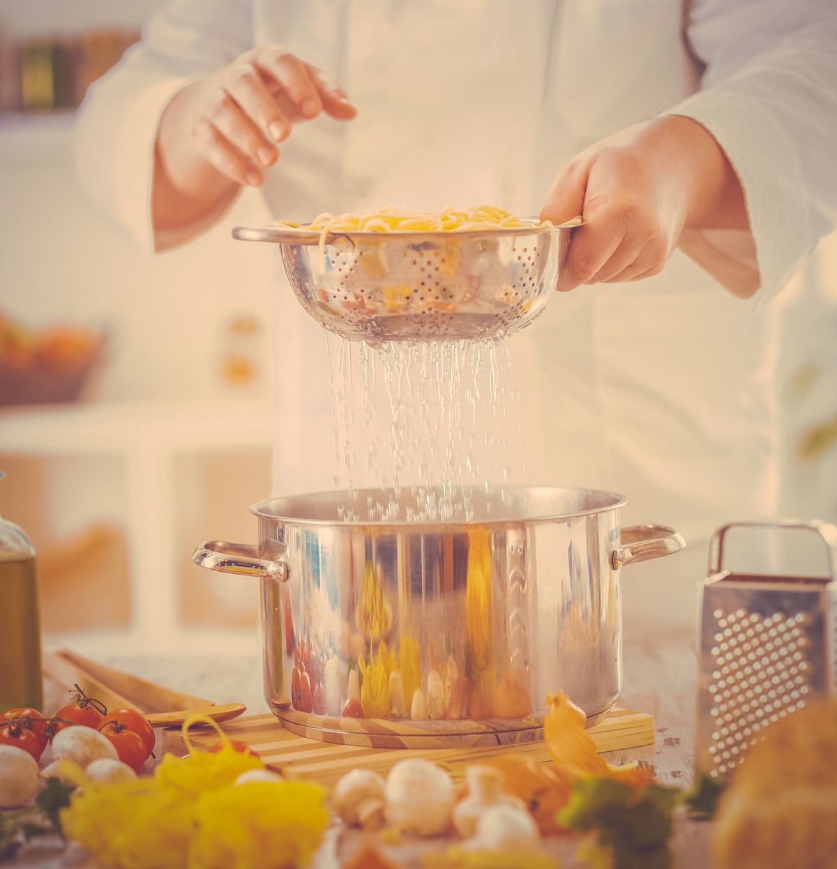 Once your pasta's boiled, strain it in a colander and place it over a pot so that the pasta water is saved.