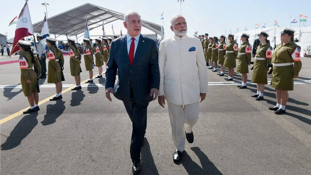 PM Modi being received by the Prime Minister of Israel, Benjamin Netanyahu, on his arrival in Tel Aviv, Israel. (Photo: PTI)