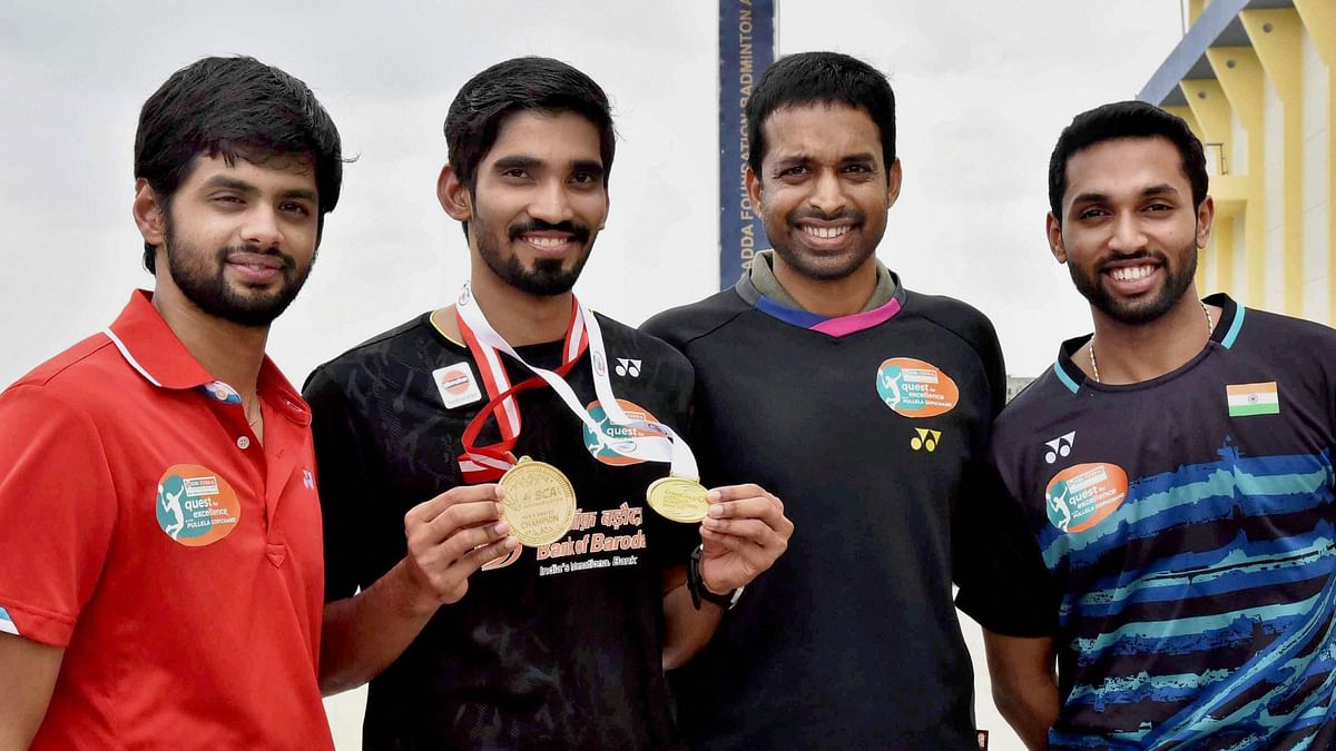 Kidambi Srikanth with coach P Gopichand and shuttlers HS Prannoy and B Sai Praneeth.