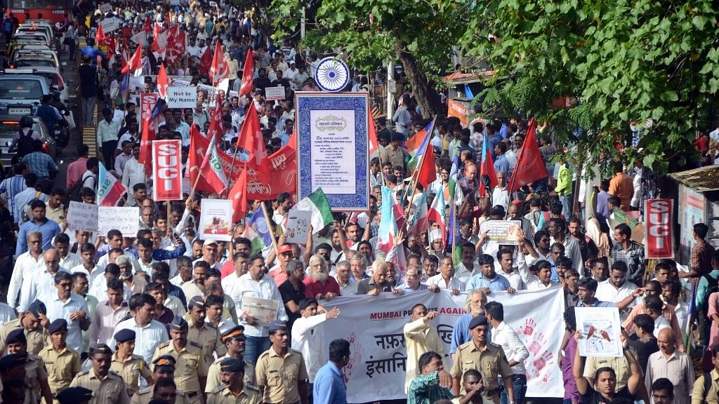 People participating in a rally against mob lynching.