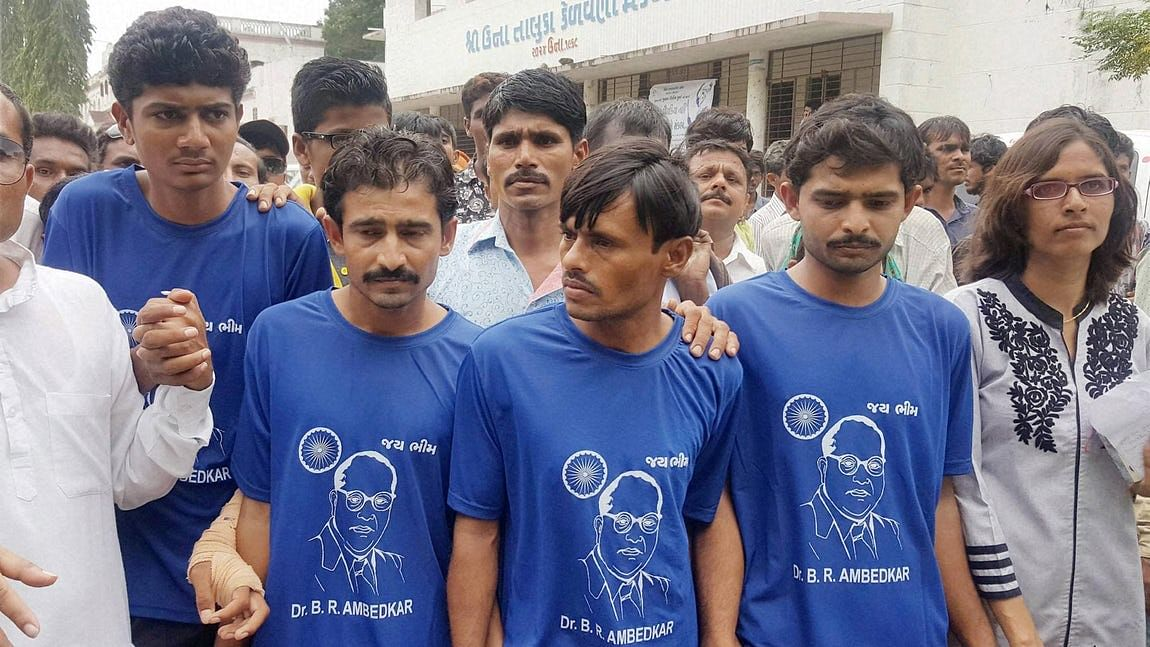 Four Dalit men who were attacked by cow-vigilantes arrive to take part in a solidarity rally in Una, Gujarat, on 15 August 2016.