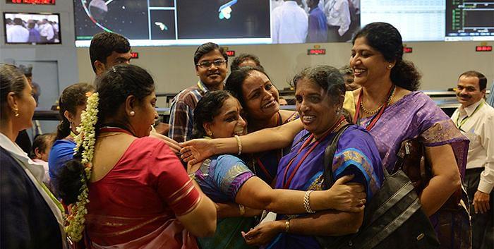 Women staff at ISRO celebrating the success of Mangalyaan.