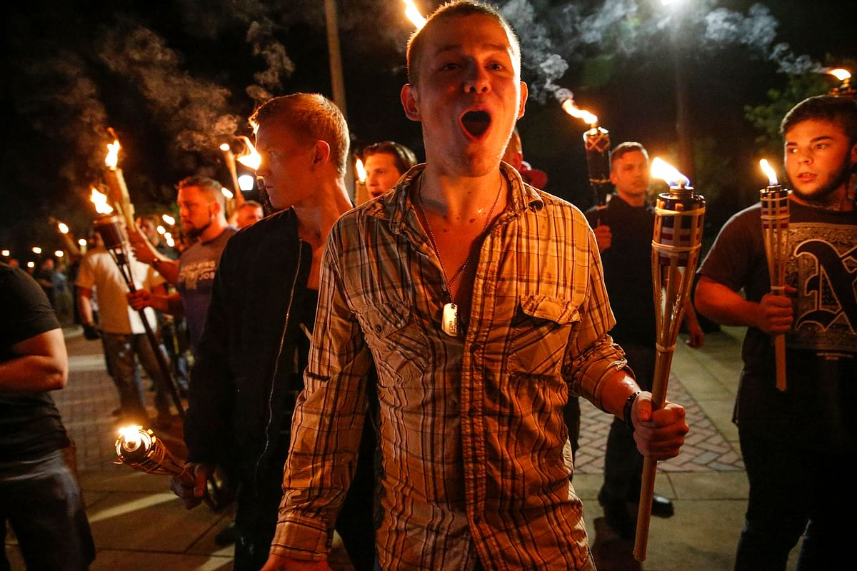 In this photo taken on 11 August 2017, Friday,  multiple white nationalist groups march with torches through the UVA campus in Charlottesville in Virginia.