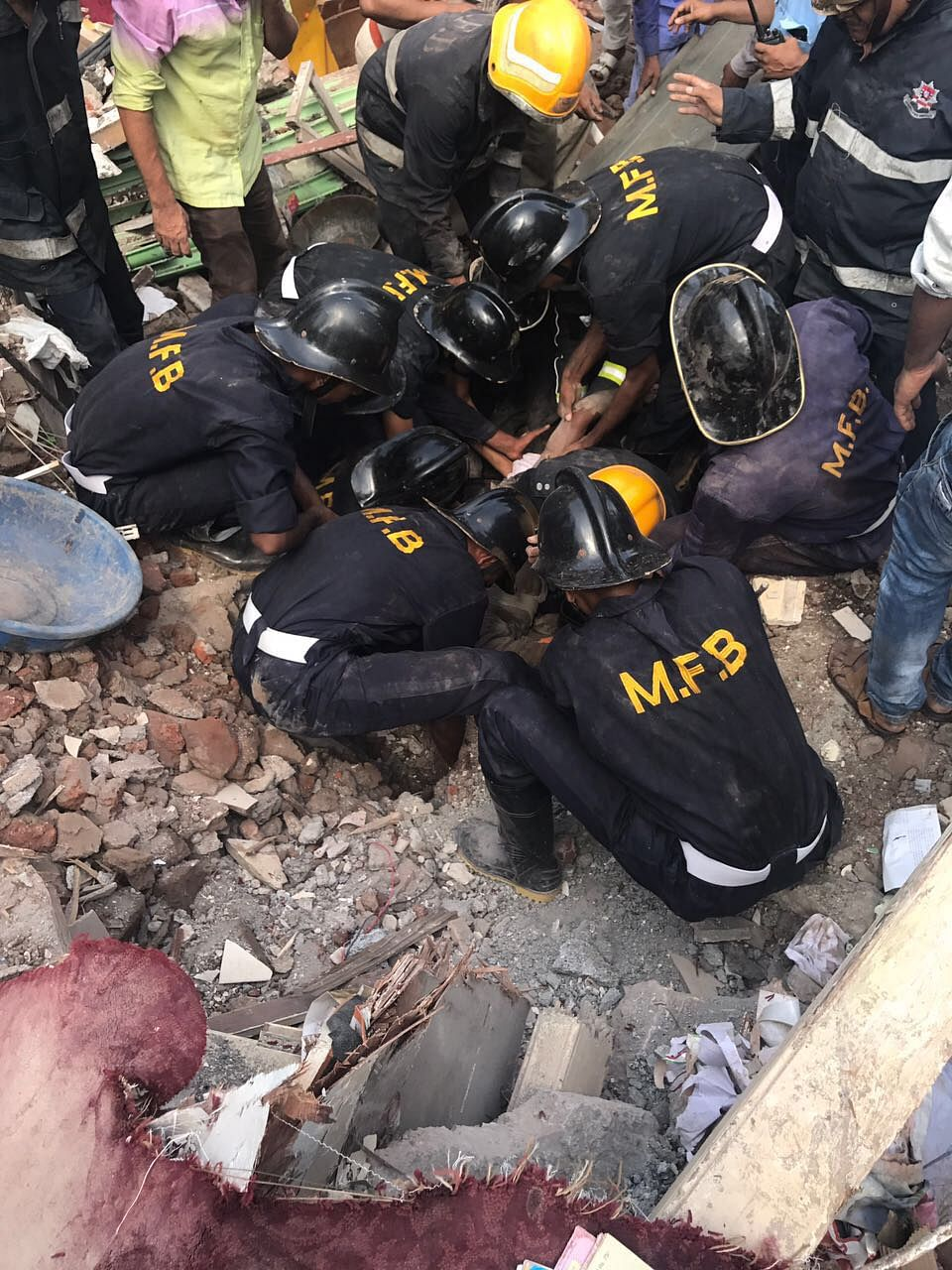 Rescue operations underway at the site of the building collapse.