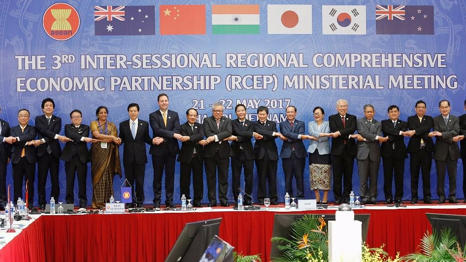 Trade ministers pose for a photo during the third inter-sessional RCEP ministerial meeting in Hanoi, Vietnam.