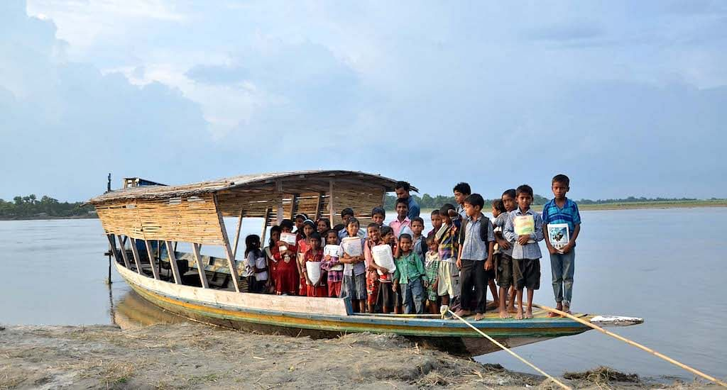 The floating school on a boat has helped children living on river islands not miss classes during the floods.