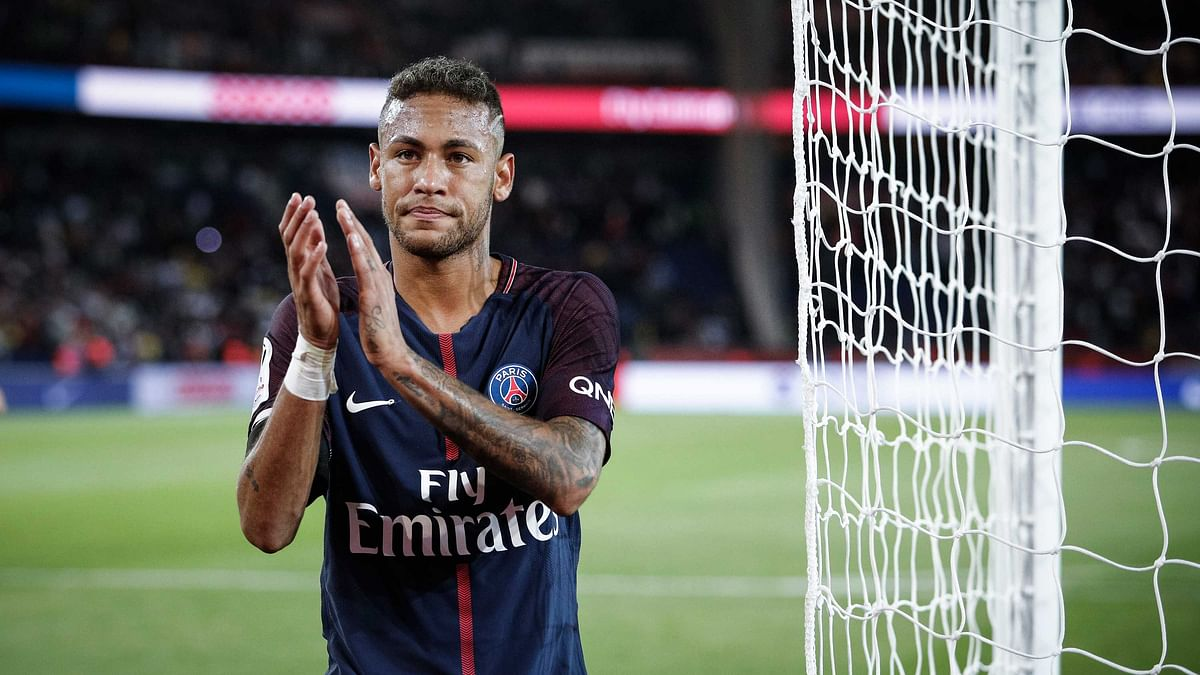 File photo of PSG's Neymar applauds with supporters after the French League One soccer match.