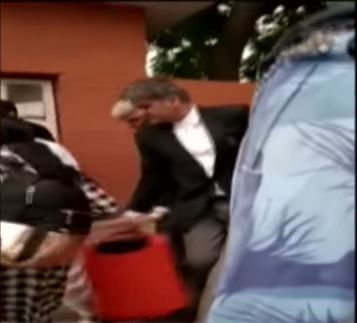 Screengrab of a video in which Deputy AG is seen carrying Ram Rahim's bag.