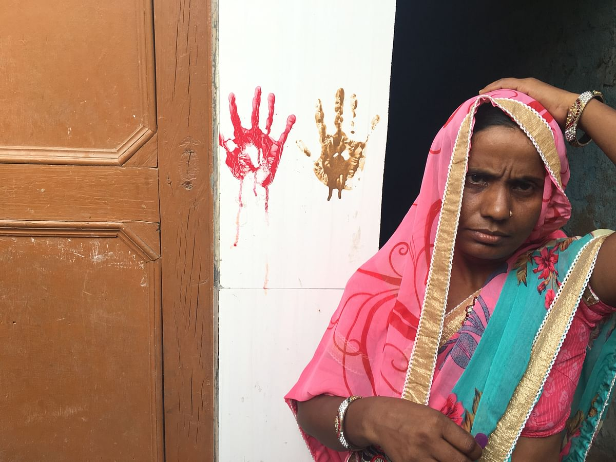 As Suman drapes the saree over her head, she says she has been distressed since this happened.