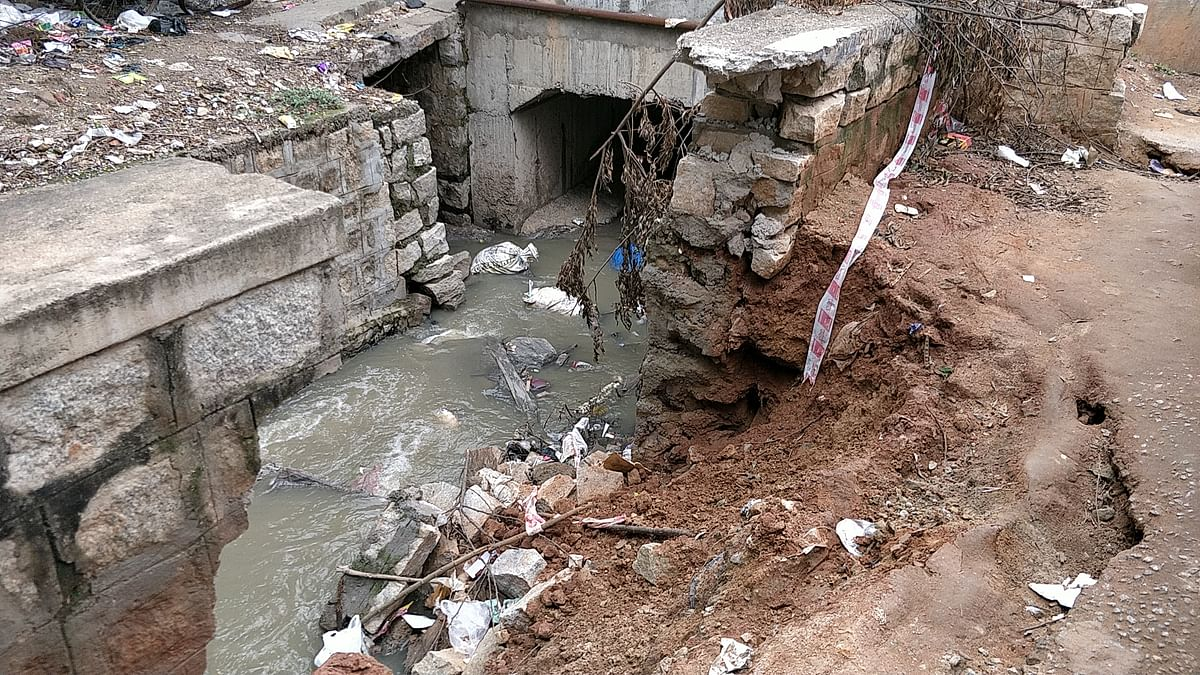 A portion of storm water drain  in Lingarajapuram, where Abhishek was washed away, remains open.
