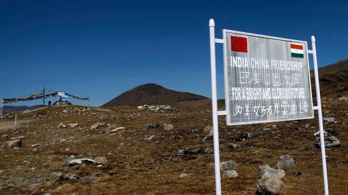 A signboard is seen from the Indian side of the Indo-China border at Bumla, Arunachal Pradesh.