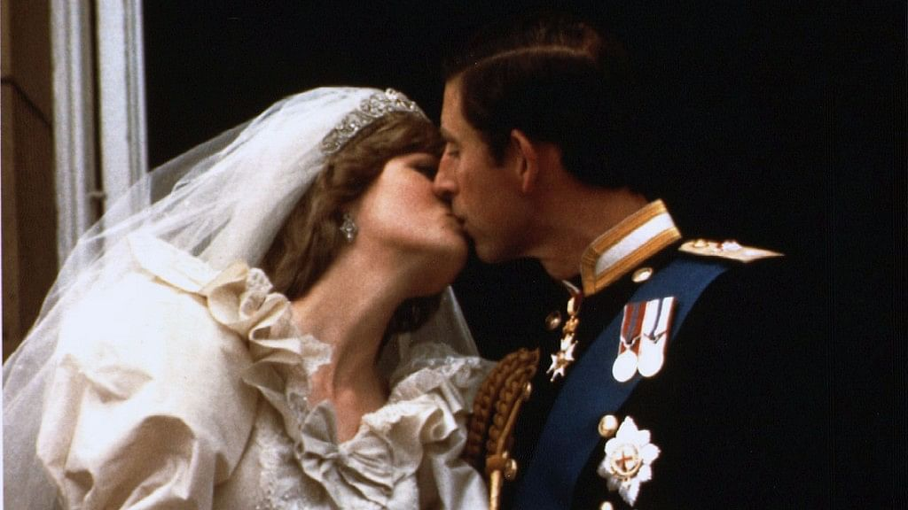 Prince Charles kisses his new bride Diana on their wedding day 29 July  1981