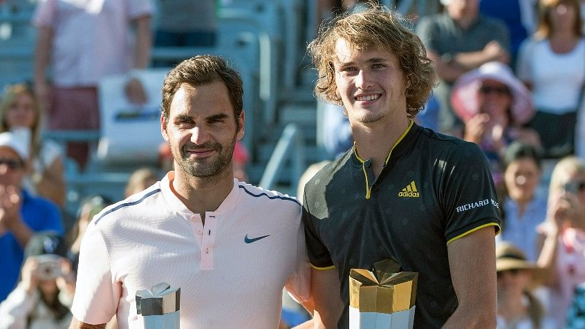 Roger Federer and Alexander Zverev pose for a photo after the Rogers Cup final.