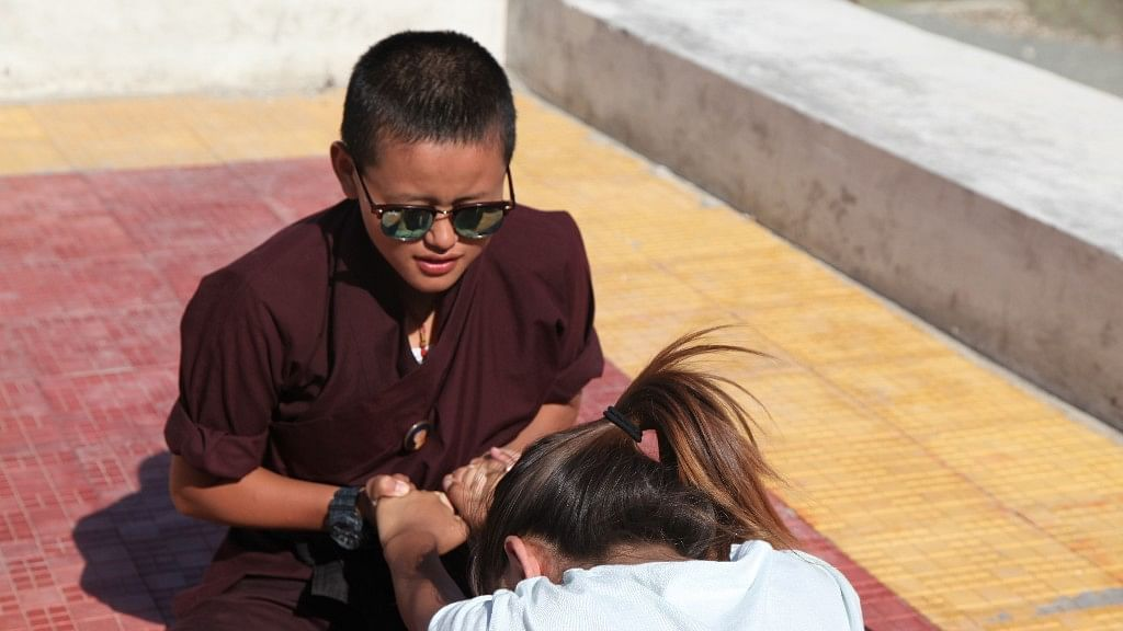 A trained martial arts expert nun, training a young female.