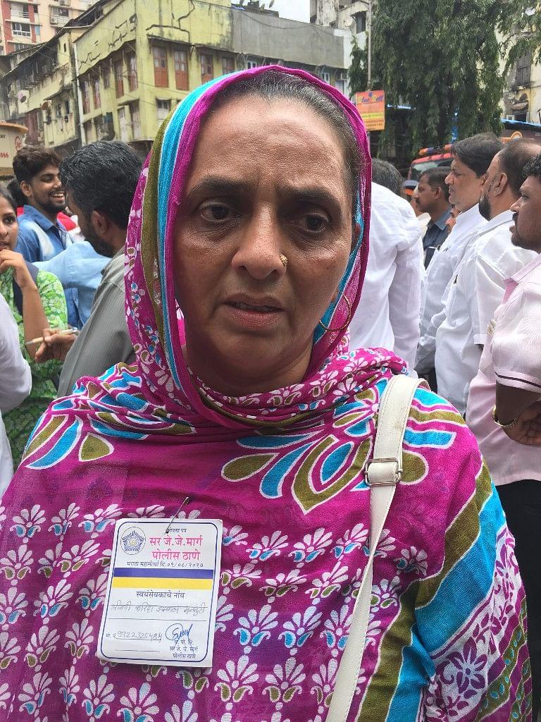 Fareeda Iqbal Mansoori volunteers to help at the collapse site.