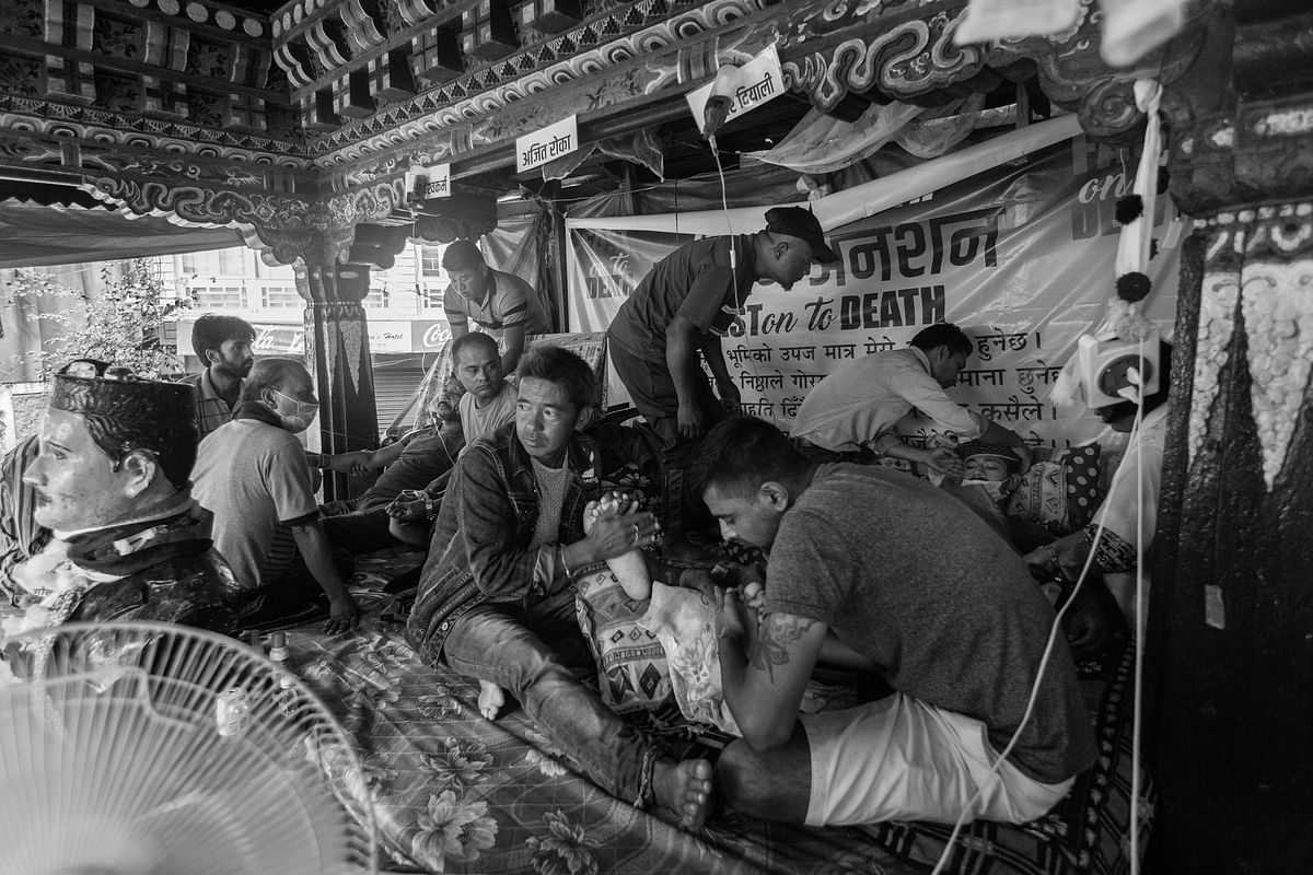 Gorkhaland supporters help three Activists of GJM's youth wing, the Yuva Morcha, sitting inside a sheltered house observing fast-unto-death.