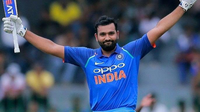 Rohit Sharma raises his bat after scoring a century in the fourth ODI against Sri Lanka.