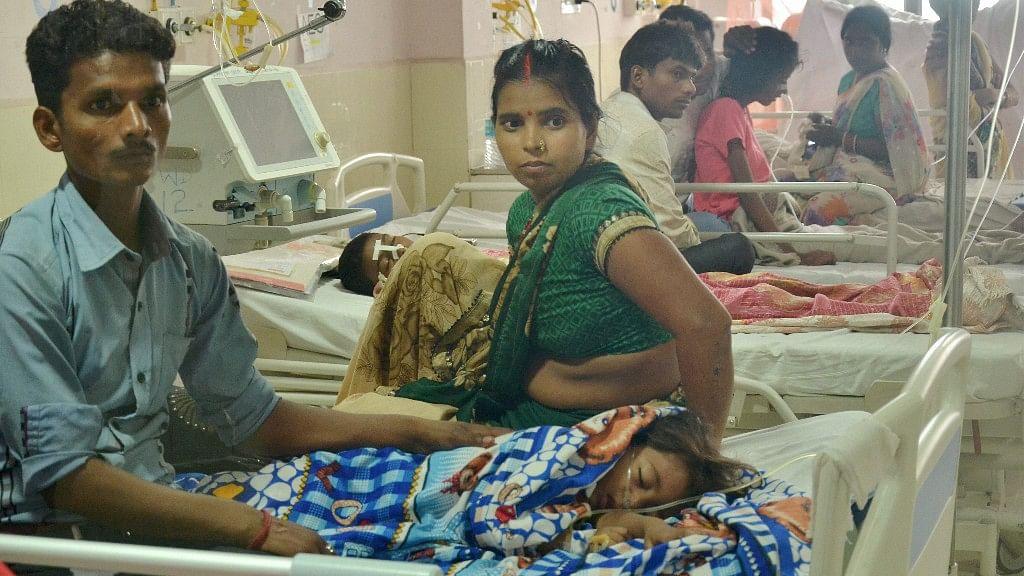Children receive treatment at the Baba Raghav Das Medical College Hospital in Gorakhpur district on Sunday.