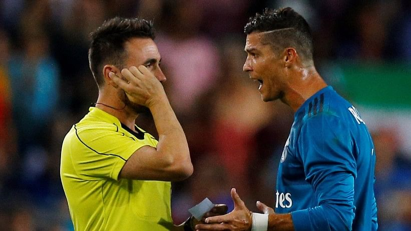 Cristiano Ronaldo speaks with referee Ricardo de Burgos Bengoetxea after being shown a red card during the Spanish Super Cup first leg against Barcelona on Sunday.