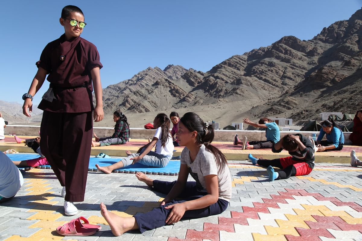 A morning training session being monitored by a young trainer nun.