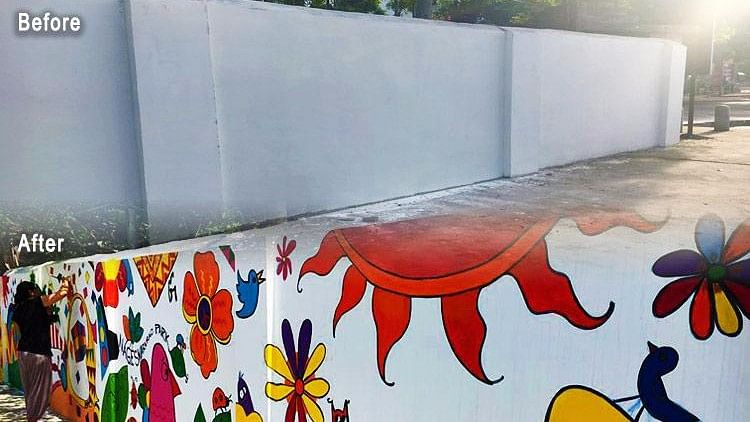 Armed with paint brushes, volunteers unleashed their creativity on a drab-looking wall.