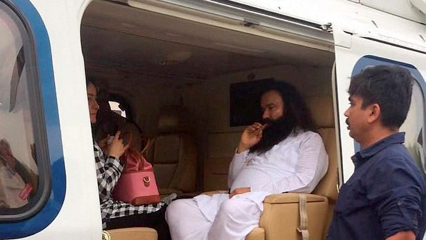 Dera Sacha Sauda chief Gurmeet Ram Rahim in a helicopter in which he was flown from Panchkula to Rohtak town, 25 August 2017.