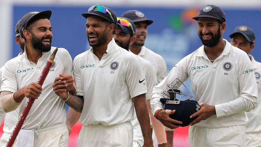 Virat Kohli and Shikhar Dhawan share a laugh at the end of the third Test against Sri Lanka.