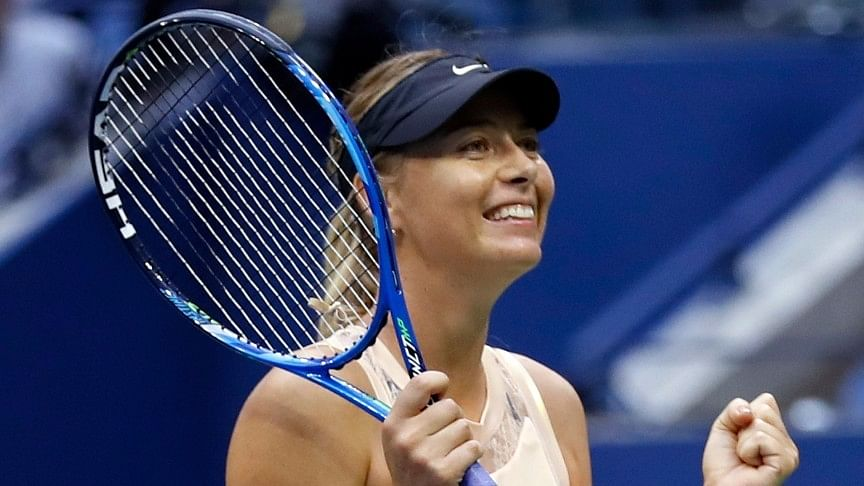 Maria Sharapova, of Russia, reacts after beating Timea Babos, of Hungary, during the second round of the US Open tennis tournament.