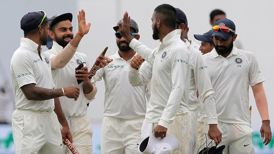 Virat Kohli celebrates with his teammates after India clinched the Test series 3-0 against Sri Lanka.