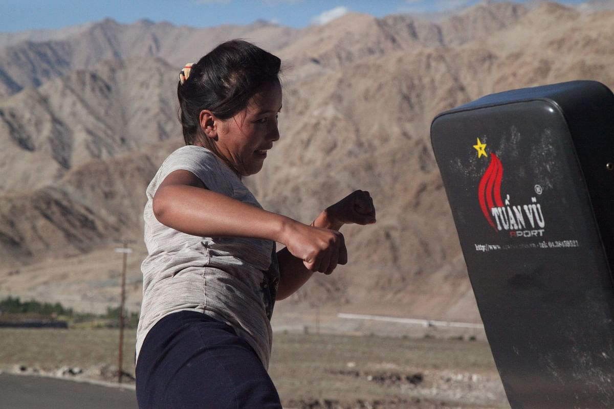 A young woman training kick-boxing in Ladakh.