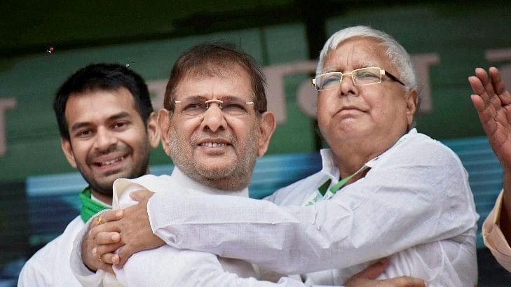 RJD chief Lalu Prasad Yadav with rebel Janata Dal-United (JD-U) leader Sharad Yadav during the 'BJP bhagao, desh bachao' rally at Patna's Gandhi Maidan.