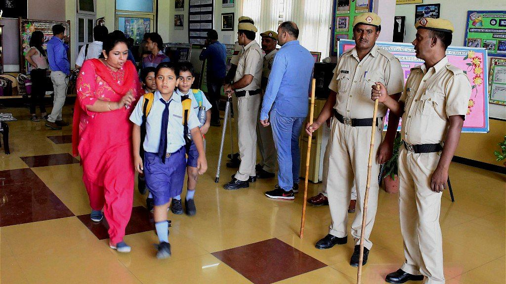 Parents taking their children back amid police presence after the murder of a 7-year-old boy at Gurugram's Ryan International School.
