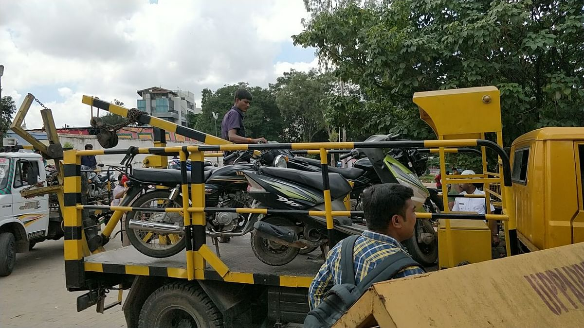 Motorcycles left behind by protesters were towed away by cops.