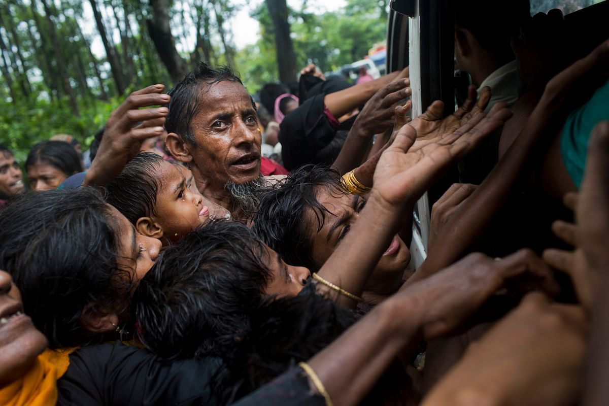 Rohingya scuffle to get aid material from local volunteers at Kutupalong, Bangladesh.