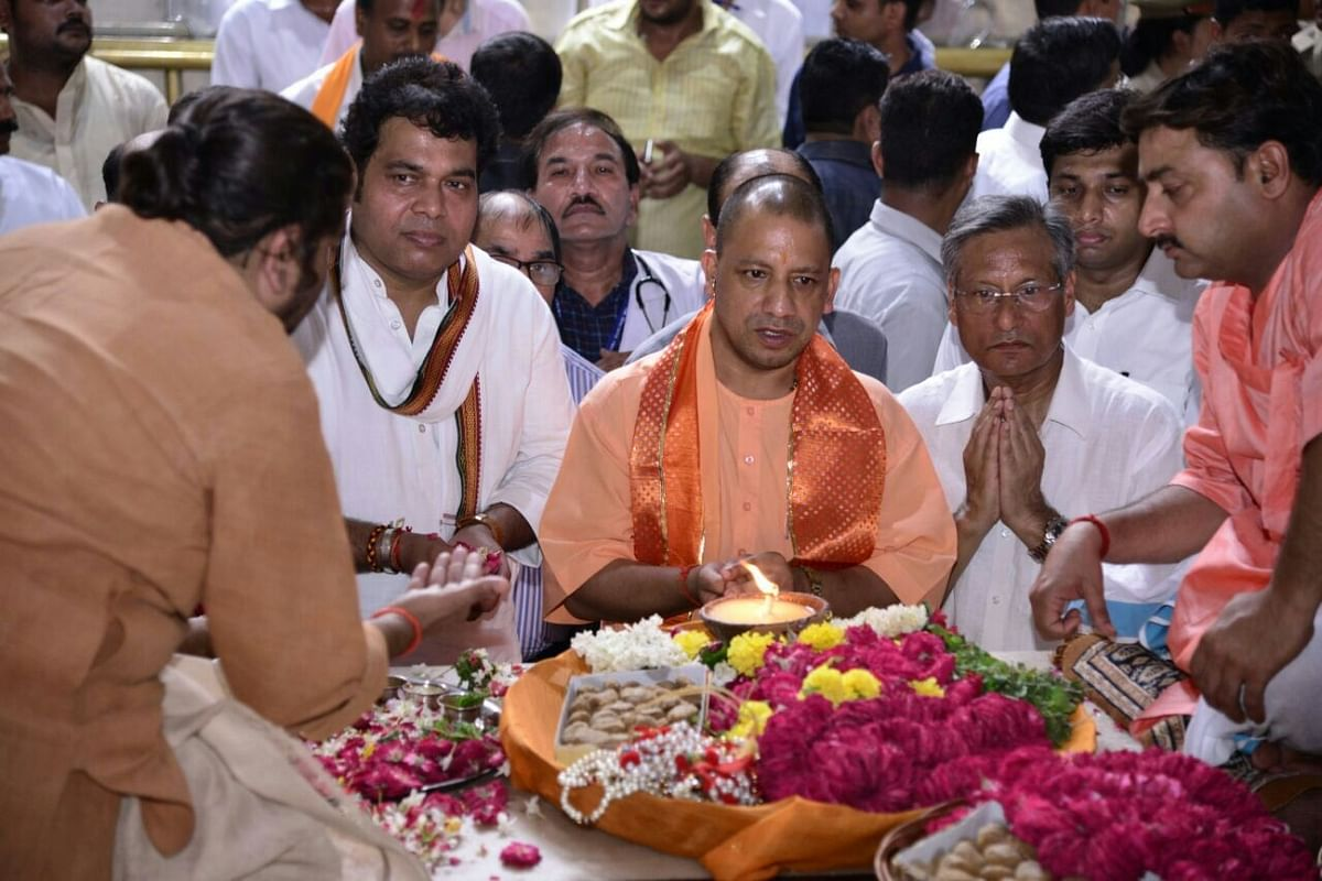 UP Chief Minister Yogi Adityanath along with UP Power Minister Shrikant Sharma during their visit to Bankey Bihari temple in Vrindavan, on 19 September 2017.