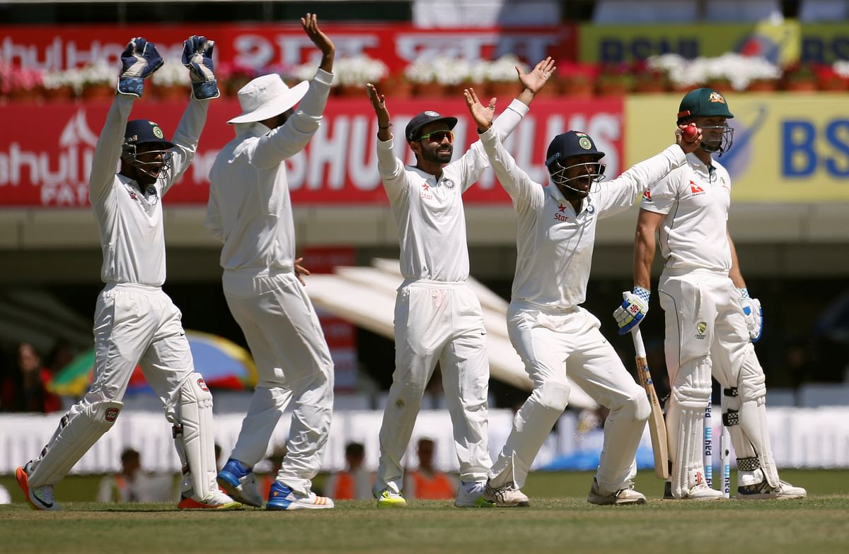 The Indian players appeal for a wicket during a Test match against Australia.