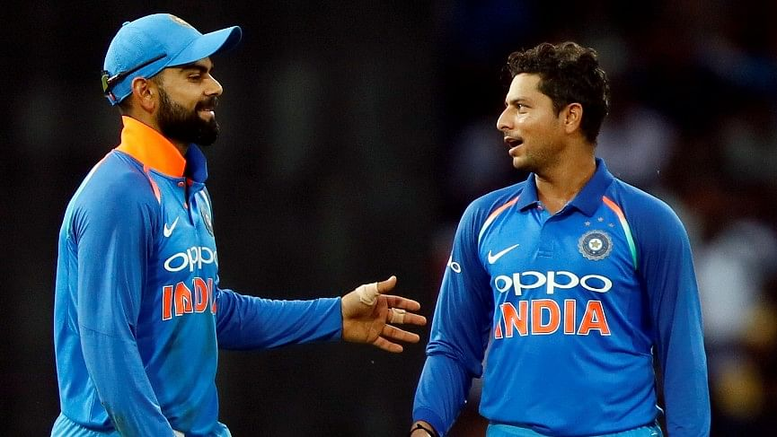 Virat Kohli and Kuldeep Yadav share a moment during an ODI.