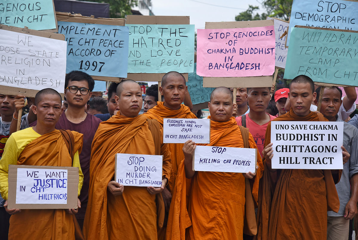 Demonstrators hold placards during a protest organised against what they say are attacks on religious minorities in Bangladesh.