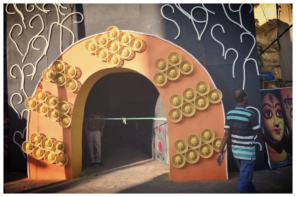 The pandal depicts DNA structures in a lab at the entrance.