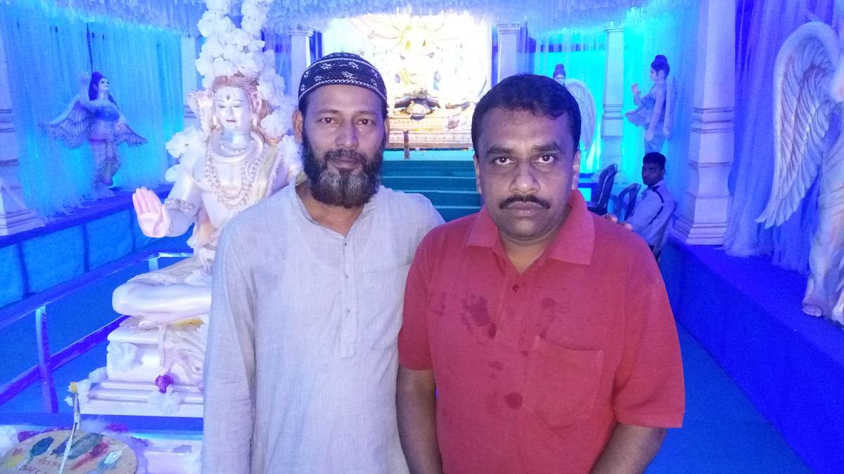 (Left) Md Rizwanullah with Santosh Mukherjee.