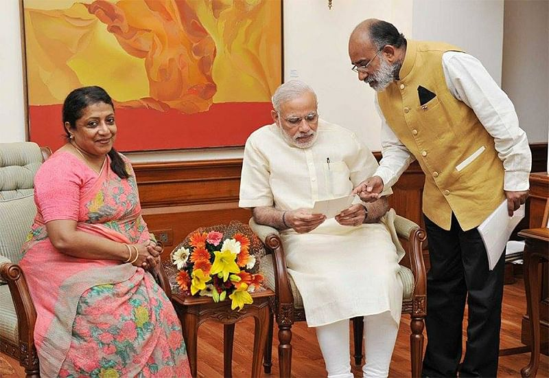 Alphons Kannanthanam with Prime Minister Modi and his wife.
