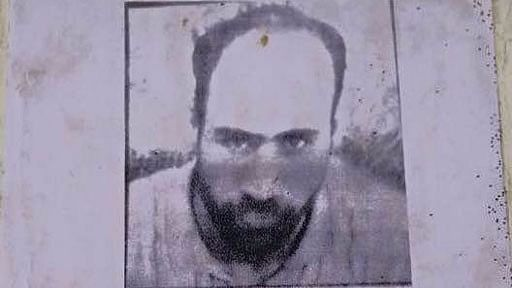 A bounty poster released by J&K Police announcing a reward of Rs 10 lakh on Abdul Qayoom Najar.   (Photo: Jehangir Ali)